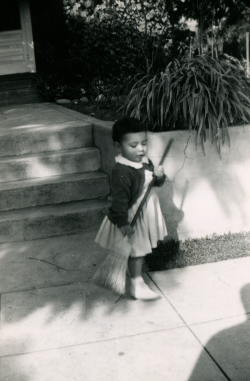 22. 1951 - kathie with broom