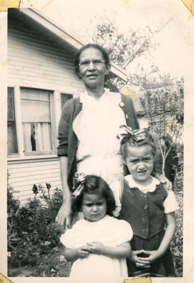 53. 1950s - grandma reyes and grandkids.