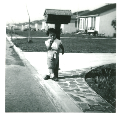 23. 1950s - kathie waiting for the mail.