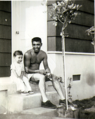 26. 1950s - kathie and dad on porch