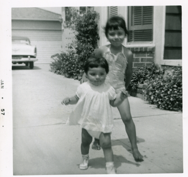 5. 1957-01 toddler michaela down the driveway with kathie