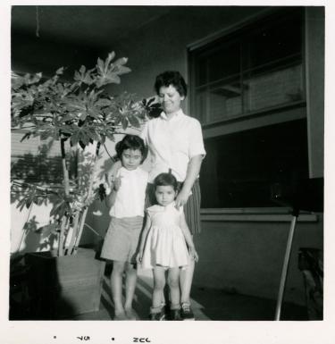 8. 1957-06 kathie, michaela & mom in the backyard