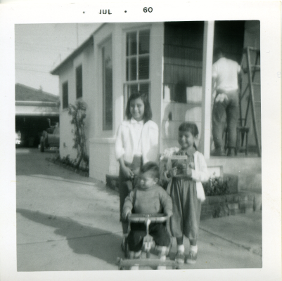 23. 1960-07 me, michaela & kathie (dad, still working on the front porch).