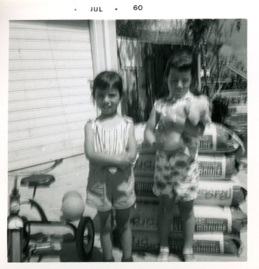 25. 1960-07 michaela & kathie (next to bags of fertilizer).