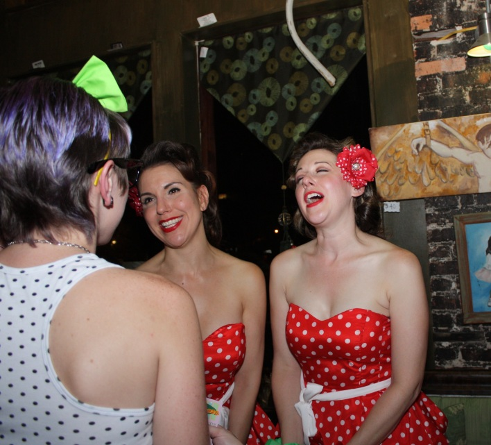 The Mint-Chippies, Pepper Mint (l) & Mary Mint (r) talk to contestant.