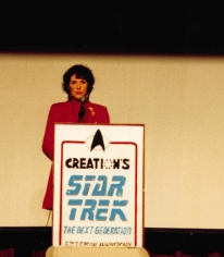 Star Trek TNG cast, Majel Barrett Roddenbury, behind the podium.