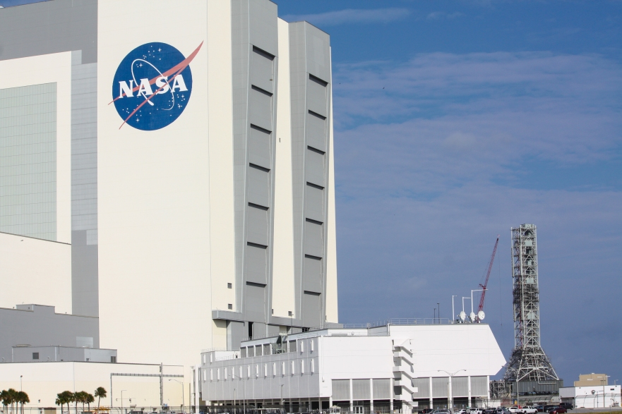 "10:50AM - NASA ""meatball"" logo & VAB"