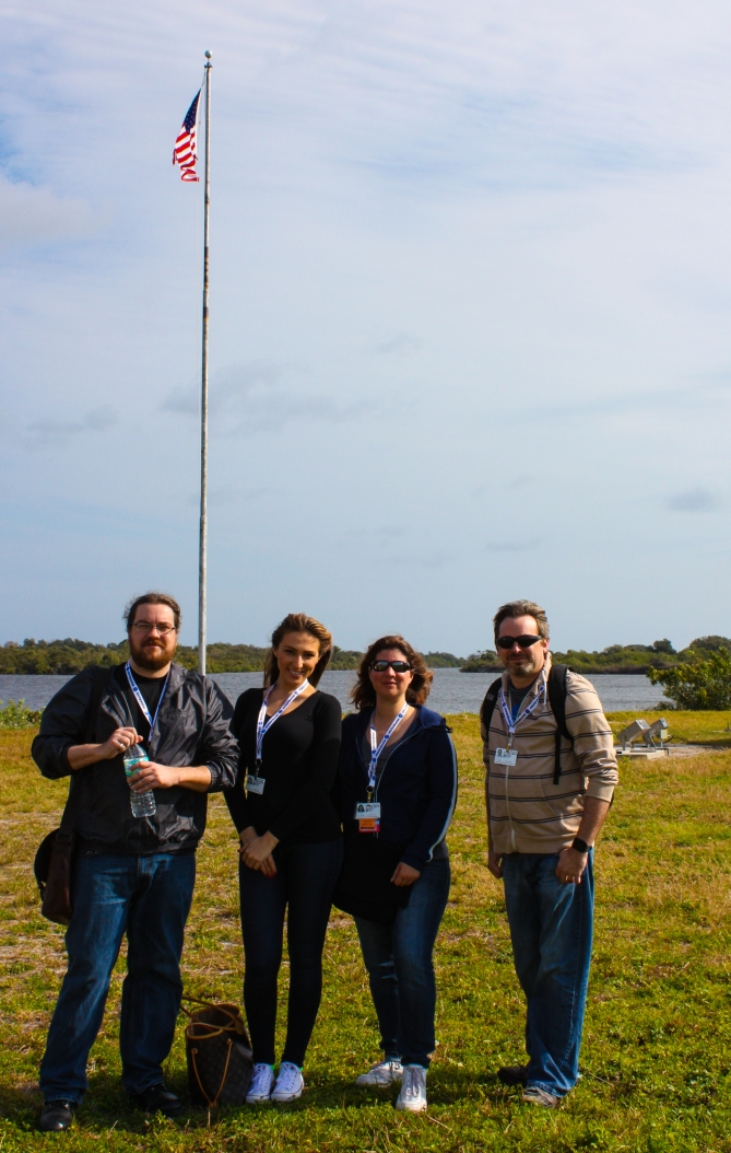 11AM - Social Media friends, Chris, Katrina, Jessika, & unknown in front of the flag near the Countdown Clock
