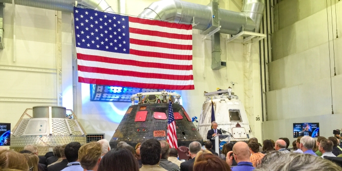 1:40PM - NASA Administrator, Charlie Bolden, in front of the Orion & Dragon capsules