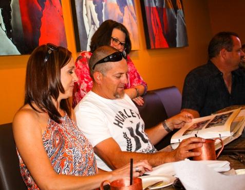2015-05-02 Irvine, CA. Remembering Creagan Gathering. Chad looks through Jen's photo albums.